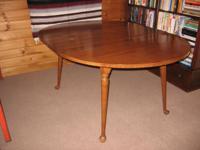 Standard style maple drop leaf dining room table with 2