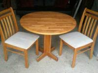 Wood drop leaf dining table with 2 chairs. Excellent