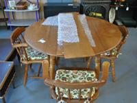 Strong wood decline leaf table w / 4 chairs and 2