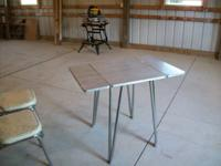 Louisville drop leaf table with 2 chairs.  36 x 24 with