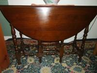 "Hi we have a cherry wood drop leaf table 13"" closed 43"""