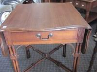 HERE IS A BEAUTIFUL SOLID OAK DROP LEAF TABLE. This is