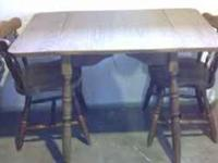 Drop leaf table is in good condition ..the chairs may