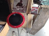 Drum practice pad and stand, music stand, metronome,