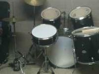 A used Mendini drum set. Hi-hats, crash/ride symbol,