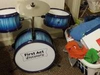 Assembled and practically brand new child drum set.
