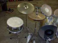 4 piece percussion plus drum set. 2 snares (marching
