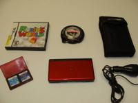 Up for sale is a Red / Burgundy DS Lite. It's clean, in