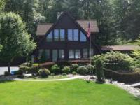 Stunning Chalet! Situated on .98 acres, This home is