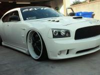 Charger has 80000 miles 24 inch dropstars rims