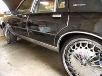 "24"" Dub Kingster Floaters coming off an Chevy Caprice"