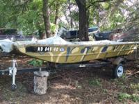 15ft Alumacraft Camo Jon watercraft and has a house