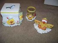 Ducky toothbrush holder, tissue box cover and cup.