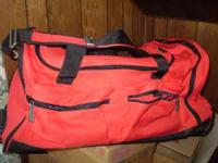 large duffle bag w/wheels and pull out handle, brand