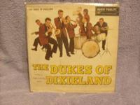 I HAVE A DUKES OF DIXIELAND L/P RECORD ALBUM. IT IS IN