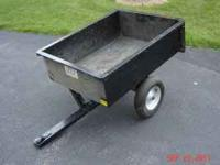 Pull behind dump cart for lawn tractor. Good
