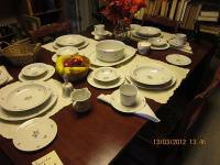 I have a 1923 Duncan Phyfe dining table and four chairs
