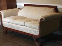 This is a replica of a Duncan Phyfe couch that was