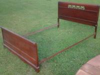 We have a Duncan Phyfe Style Double Bed.  It is in good