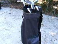 A Dunlop golf club set. Set includes: Irons- 3-9, PW;
