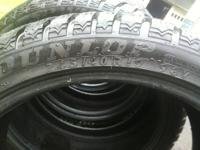 Pair of Dunlop Winter Sport M3 Snow tires. Size P245 40