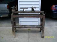 This is an old Duro brand wood lathe. It has good