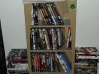 "Hello! I am selling a ""Canoe"" style shaped DVD holder."