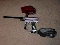 This is a Dye Matrix paintball gun that is fully