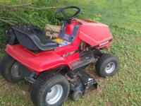 Item for sale is a Dynamark riding lawnmower. It has a