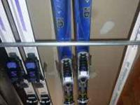 Dynastar 205cm skis with Saloman S800 bindings. In good