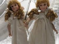 I am selling a Dynasty Doll Collection Porcelain Dolls-