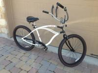 Men's cruiser-style bicycle, made by Dyno. Model is