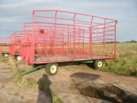EZ Trail hay racks on 8 ton running gear 2 on John