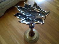 This is a vintage leaf ashtray with gold trim. The