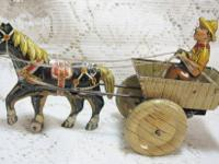#1125Tg- This is a great early 1900s toy..a cast iron