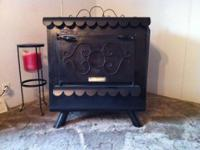 For Sale, The Earth Stove wood stove series 600 holds