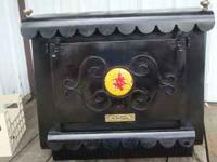 WOOD BURNING FIREPLACE INCERT MADE BY EARTH STOVE ,