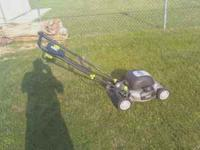 This is a one year old 20 inch electric lawn mower. I