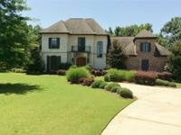 Secluded in the gated community of Eastbrooke Estates