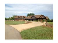 This gorgeous 238 acre estate lies at 404 Shady Dale Rd
