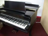 Small Grand Piano and matching bench sounds nice plays