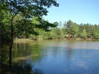 Country homesite with a beautiful pond on level, wooded