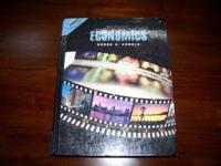 Economics . Good Condition $15.00. Call or text :