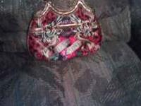 Everybody loves Ed Hardy. Real Deal Ed Hardy purse.