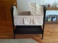 Dark Chery Wood Eddie Bauer Bassinet. Very nice and