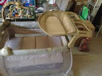 A Eddie Bauer Care Baby play yard, turn to baby crib,