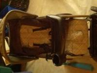 Eddie Bauer stroller. Tan and beige color. Used as is