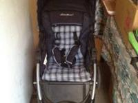 Matching stroller and infant car seat in blue.
