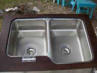 Eight brand new Kohler sinks bought from a supply house