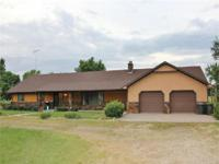 Your new home in the country. This 3 bedroom home has 4